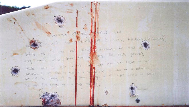 The prosecution presented this photo as evidence of the handwritten note found inside the boat where Dzhokhar Tsarnaev was captured April 19, 2013, in Watertown, Mass., four days after the bombings.