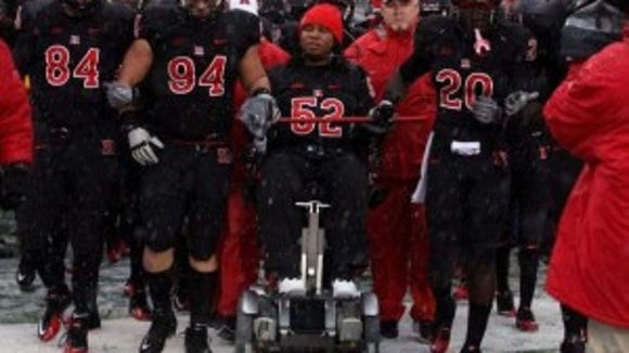 Eric LeGrand (52) challenged former Rutgers teammate and close friend Khaseem (Eric LeGrand (52) challenged former Rutgers teammate and close friend Khaseem Grene (20) to the ALS Ice Bucket Challenge. (File photo)