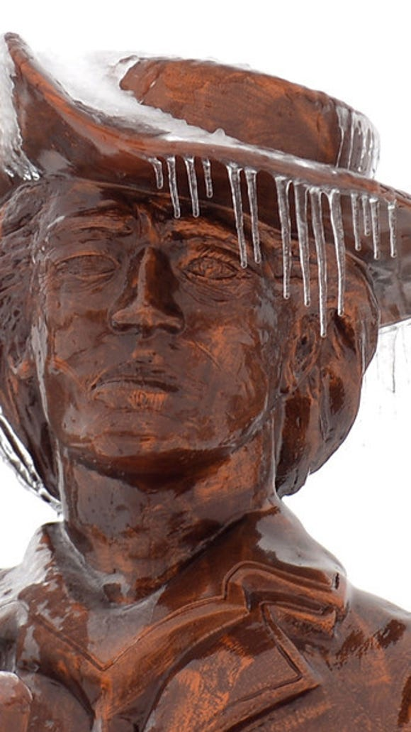 Icicles hang from the Minuteman statue outside of the Edward Martin Hall, Pennsylvania National Guard Joint Force Headquarters at Ft. Indiantown Gap on Wednesday, Feb. 5, 2014. An ice storm that hit the Lebanon Valley Feb 4-5, 2014. Jeremy Long -- Lebanon Daily News