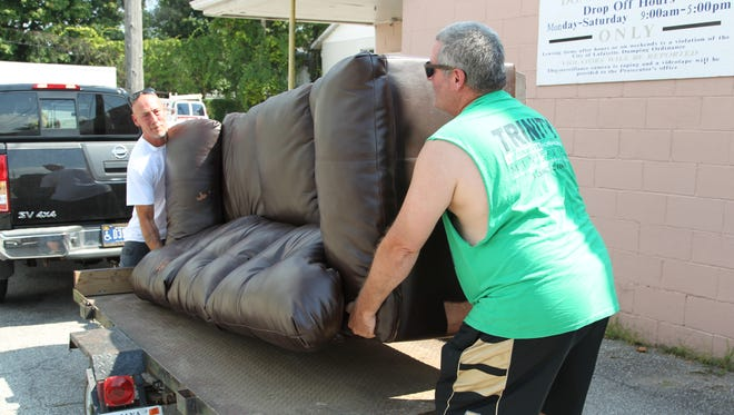 Neal Clawson (right) and Jeff Thomack moved a couch donated Tuesday to Trinity Life Ministry's thrift store in Lafayette. Thomack also is participating in the organization's drug rehabilitation program in Crawfordsville.