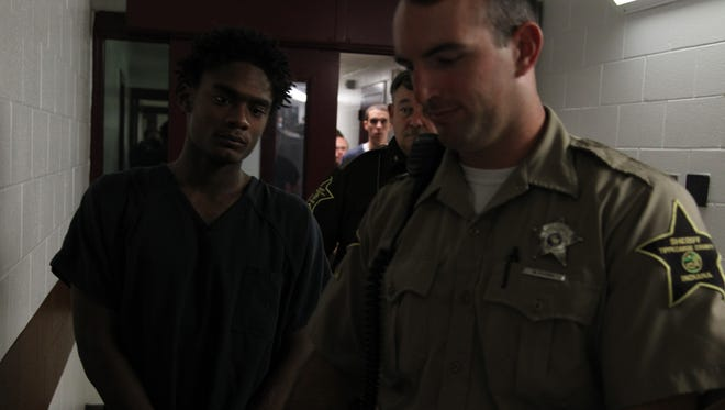 Darius Javon Printup (left), 18, appears in court Monday after he was arrested in the fatal shooting of 52-year-old Kristi Redmon.
