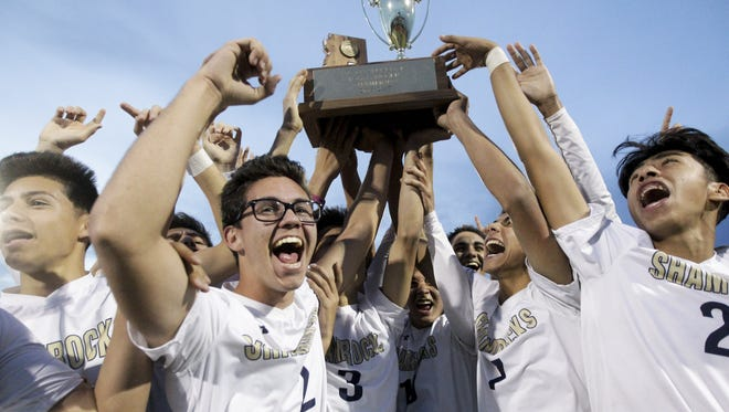 Yuma Catholic celebrates after defeating NFL YET Academy to win the state 3A title at Williams Field High School in Gilbert on Saturday, Feb. 11, 2017.