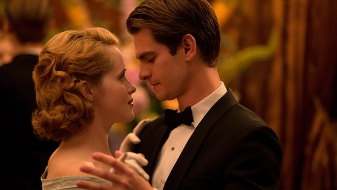 """Diana (Claire Foy) and Robin (Andrew Garfield) fall fast in """"Breathe."""""""