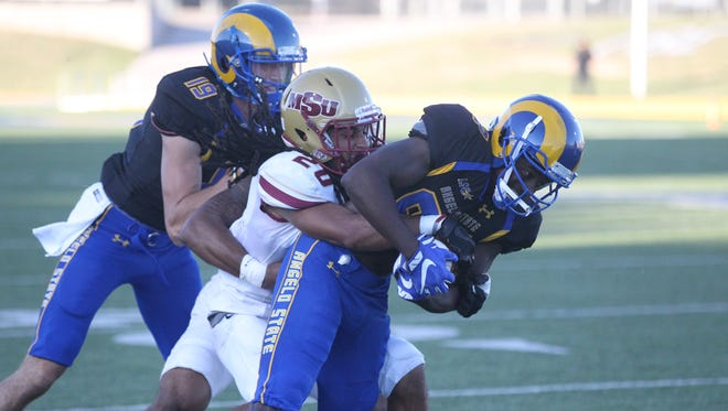 Angelo State University freshman running back Tyrese Nathan (right) had a career-high 138 yards rushing against No. 6 Midwestern State during a Lone Star Conference game at LeGrand Stadium at 1st Community Credit Union Field on Saturday, Oct. 14, 2017. The Mustangs won 41-27.