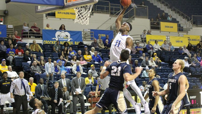 Angelo State University's Brandon Williams (11) goes up for a slam dunk against St. Edward's during the final day of the Ed Messbarger Tip-off Classic at the Junell Center on Saturday, Nov. 18, 2017. The Rams won 106-93 to improve to 4-0.