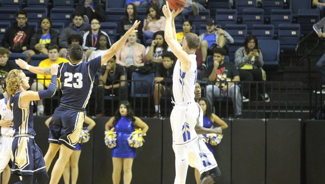 Angelo State University's Will Adler (right) puts up a shot against St. Edward's Dorian Lopez during the final day of the Ed Messbarger Tip-off Classic at the Junell Center on Saturday, Nov. 18, 2017. The Rams won 106-93 to improve to 4-0.
