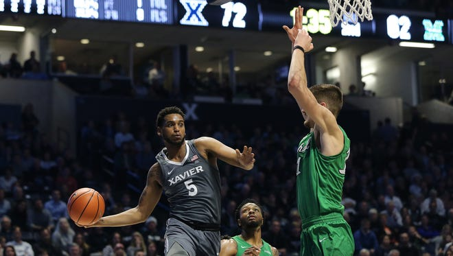 Xavier Musketeers guard Trevon Bluiett (5) passes along the baseline in the second half during the college basketball game between the Marshall Thundering Herd and the Xavier Musketeers, Tuesday, Dec. 19, 2017, at Cintas Center in Cincinnati.