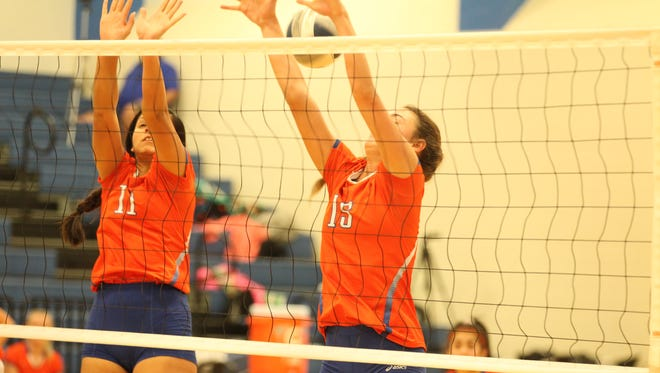 San Angelo Central High School's Kirsten Gomez (11) and Trinity Southall try to block a shot by Bushland in the third-place match of the Gold Division of the Nita Vannoy Memorial Volleyball Tournament at Lake View's Ben Norton Gym on Saturday, Aug. 18, 2018.