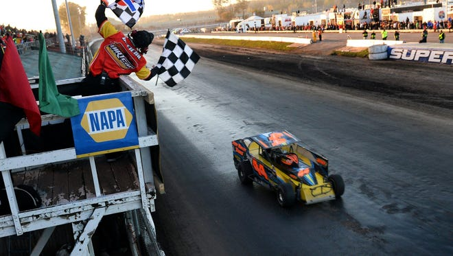 Stewart Friesen takes the checkered flag to win the 2014 NAPA Super DIRT Week Syracuse 200 at the New York State Fairgrounds in Syracuse, N.Y.