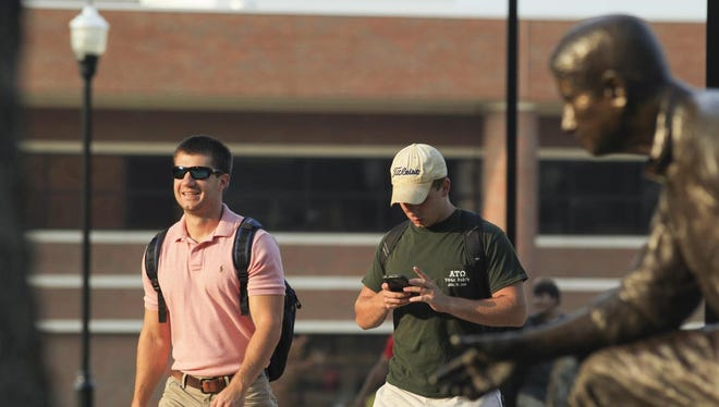 Peter Wood walks with Tyler Radford on the first day of classes during the fall of 2013 at the University of Tennessee at Martin.