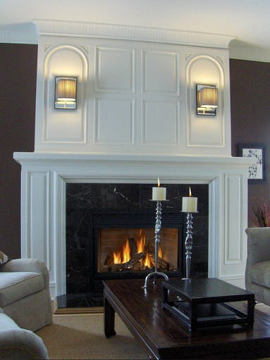 Marble tiles around the fireplace opening are both