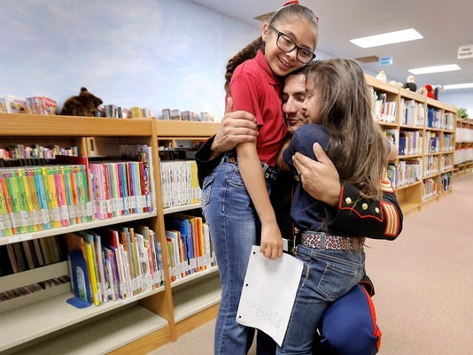 Sisters at Frank Macias Elementary School had their best school day ever Thursday when their father, Marine Gunnery Sgt. Hector Vargas, surprised them after being on an overseas tour for the past 18 months. The girls, Breehana Tarango, 10, and Kayley Tarango, 7, were reading their essays about their hero, their father, when he emerged from behind a shelf of books in the school's library.