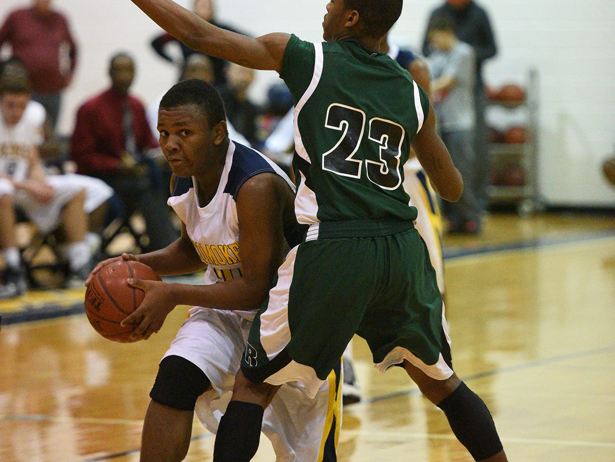 Pocomoke's Licurtis Whitney drives past Parkside's Juwan Williams.