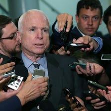 Sen. John McCain, R-Ariz., talks to reporters.