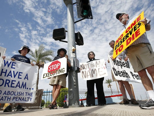 John Zemblidge, right, of Phoenix, leads a group of