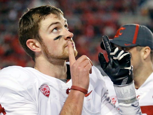 Washington State quarterback Luke Falk (4) points skyward after throwing a touchdown against Utah in the second half during an NCAA college football game, Saturday, Nov. 11, 2017, in Salt Lake City. (AP Photo/Rick Bowmer)