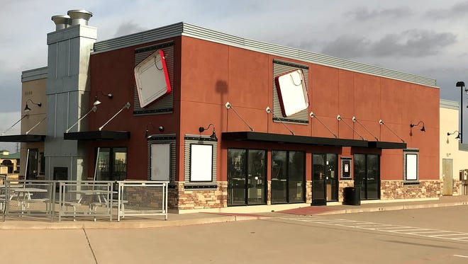 This building has sat vacant since 2011 when a state tax lien was filed against the Jack in the Box franchisee. Inside, chairs are still stacked neatly on tables as if the restaurant is waiting to open.