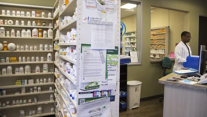 Dr. Lucas Nyabero fills prescriptions, February 29, 2016, at NewSpring Pharmacy, 10750 W McDowell Road, Avondale.