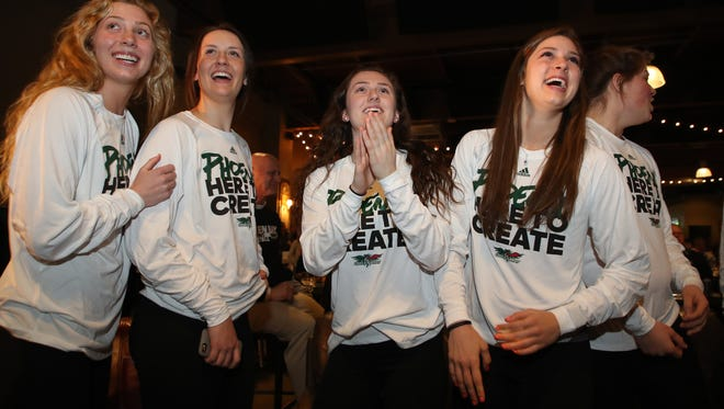 Anna Brecht, Caitlyn Hibner, Meghan Pingel and Laken James celebrate their team's announcement during the NCAA Women's Basketball Championship selection show Monday, March 12, 2018 at the Green Bay Distillery in Ashwaubenon, Wis.