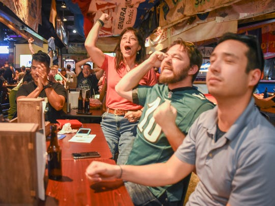 Football fans watch the New England Patriots and the Philadelphia Eagles fight for yardage in Super Bowl 52 at the Horse & Cow Pub & Grill in Tamuning on Monday, Feb. 5, 2018.