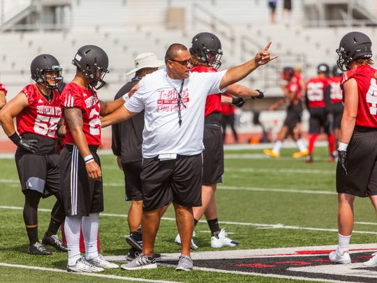 Southern Utah linebackers coach Solomona Tapasa talks to his players during fall camp in 2016.
