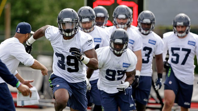 Eric Pinkins (39) leads others as they take part in drills at Seattle Seahawks NFL football rookie minicamp Sunday, May 10, 2015, in Renton, Wash.