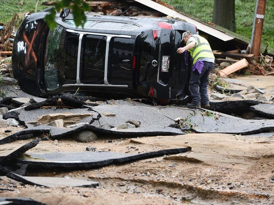 The Latest on flood: Searchers find body of missing Maryland man