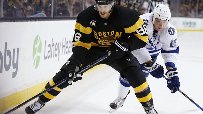 Boston's Kevan Miller, shown in a 2017 game battling Tampa Bay' Ondrej Palat for the puck, (18), admits he's a little concerned about his latest comeback from a knee injury.