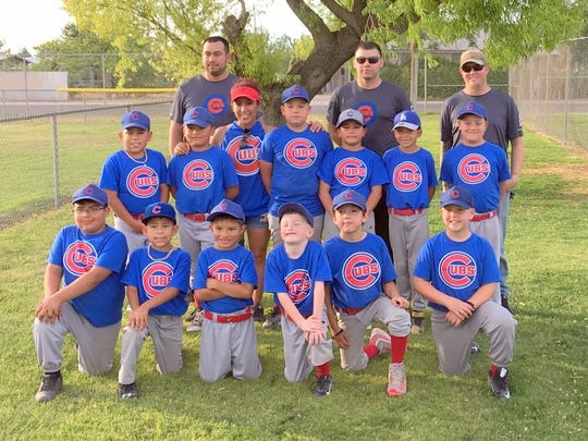 Christy Reyes volunteered to help with the Cubs of the Deming Coach-Pitch League.