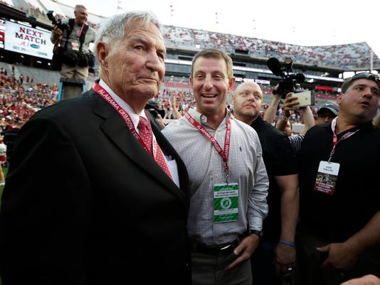 Former Alabama coach Gene Stallings, left, and current Clemson coach and former Alabama player Dabo Swinney, center, meet on the field before an NCAA college football game between the teams, Saturday, Oct. 14, 2017, in Tuscaloosa, Ala. (AP Photo/Brynn Anderson)