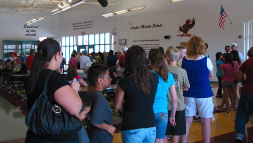 Students line up for registration at Charles A. Hughes Middle School.
