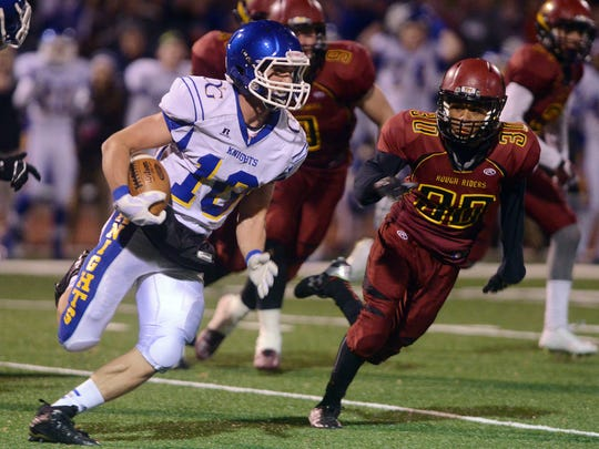 O'Gorman's Luke Fritsch carries the ball past Roosevelt's