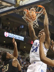 Duke's Wendell Carter Jr. dunks against the win over