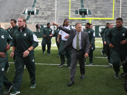 Mark Dantonio leads his team onto the field before the game against Oregon on Sept. 12 in East Lansing.