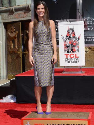 Sandra Bullock poses as she is immortalized with a hand and footprint ceremony at TCL Chinese Theatre on Sept. 25 in Hollywood.