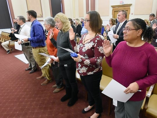 A canvassing board was sworn in to conduct a recount