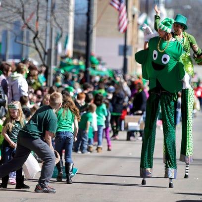 The Jolly Giants stilt walkers entertain the crowd