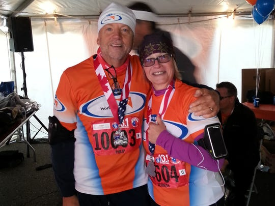 Phil Little and his wife, Debbie. Phil started running to celebrate.