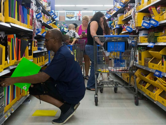Shoppers search for back-to-school supplies at the