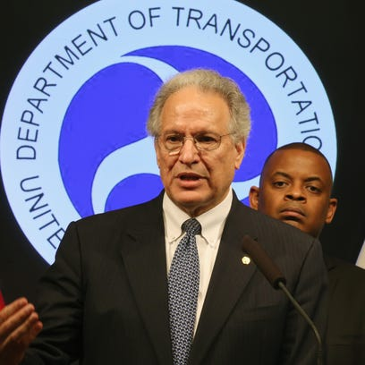 NHTSA Administrator Mark Rosekind, with Transportation Secretary Anthony Foxx over his shoulder, speaks about the Takata air bag recall during a news conference