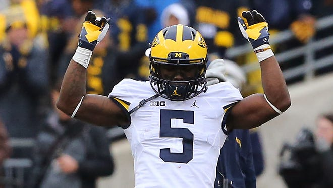 Nov 26, 2016; Columbus, OH, USA; Michigan Wolverines linebacker Jabrill Peppers (5) celebrates the teams touchdown during the second quarter against the Ohio State Buckeyes at Ohio Stadium. Michigan Wolverines lead at half 10-7.  Mandatory Credit: Joe Maiorana-USA TODAY Sports