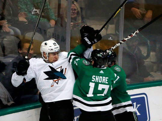 San Jose Sharks right wing Timo Meier (28) and Dallas Stars center Devin Shore (17) and Stars center Tyler Seguin (91) fight during the second period of an NHL hockey game in Dallas, Sunday, Dec. 31, 2017. (AP Photo/Michael Ainsworth)