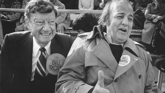 Sen. Bill Roth (left) and former White House press secretary James Brady were among an overflow crowd of more than 20,000 fans who watched the University of Delaware beat Towson State 51-7 on Oct. 23, 1982.