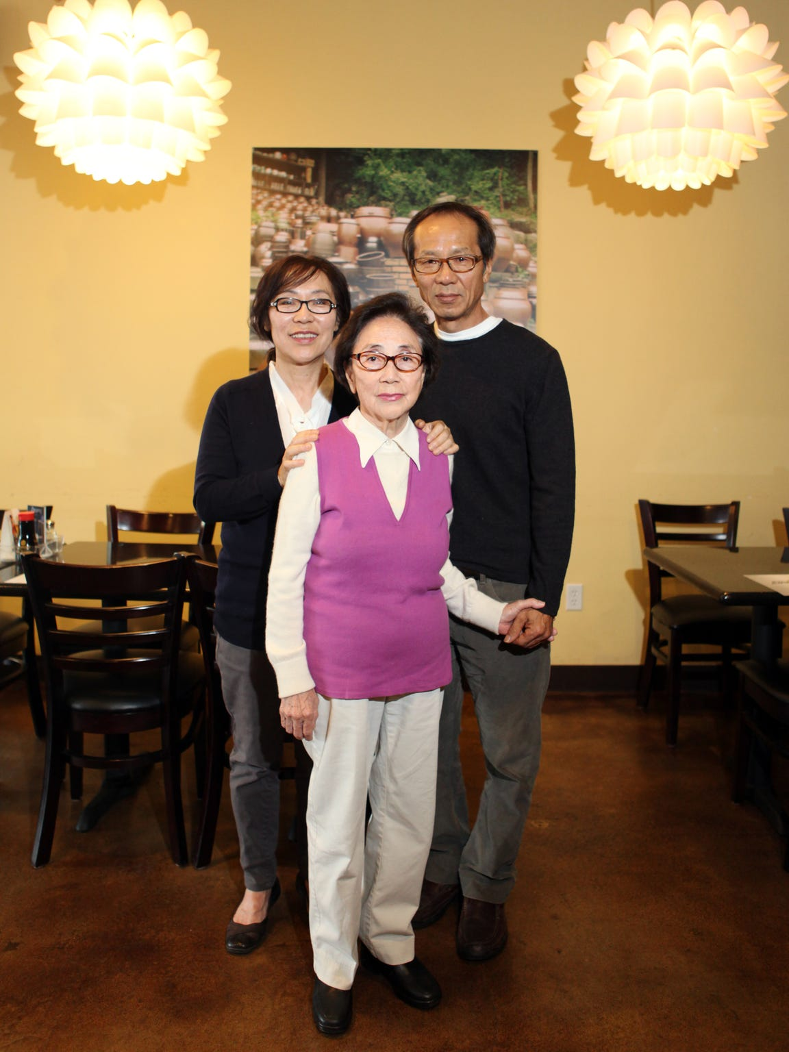 The Kim Family: (From left) Seung Hee Kim, 55, Ok Ja Choi, 80, and Sung Hoon Kim, 58, at their Korean restaurant Maru on Friday, November 22, 2013 in La Quinta, Calif.