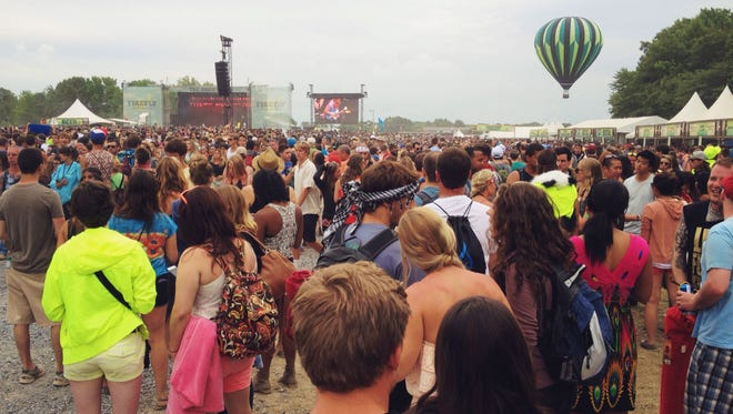 A large crowd gathers to hear Cage the Elephant at the main stage at the 2104 Firefly.