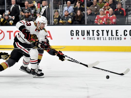 Chicago Blackhawks right wing Tomas Jurco skates with the puck against the Vegas Golden Knights during the first period of an NHL hockey game Tuesday, Feb. 13, 2018, in Las Vegas. (AP Photo/David Becker)