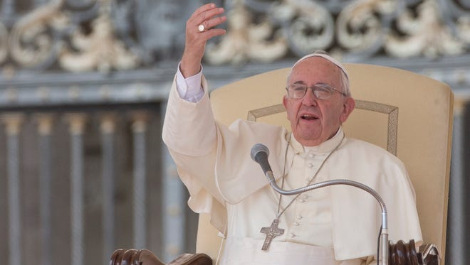 Pope Francis delivers his speech during his weekly general audience in St. Peter's Square at the Vatican, on Sept. 9, 2015.