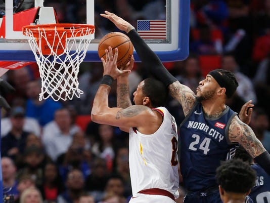 Detroit Pistons forward Eric Moreland (24) defends against a shot by Cleveland Cavaliers forward Channing Frye (8) during the first half of an NBA basketball game Tuesday, Jan. 30, 2018, in Detroit. (AP Photo/Duane Burleson)