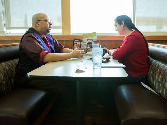 Micah Pearson, artist and advocate, speaks with reporter Diana Alba-Soular at a restaurant on Wednesday, April 12, 2017. Pearson has been diagnosed with bi-polar disorder, attention deficit hyperactive disorder and post-dramatic stress disorder. He is also president of the Doña Ana Chapter of National Alliance on Mental Illness and is a peer support specialist with Doña Ana County's Assisted Outpatient Treatment Program.