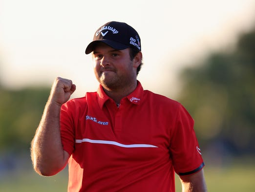 Patrick Reed celebrates his one-stroke victory on the 18th green during the final round of the World Golf Championships-Cadillac Championship at Trump National Doral.